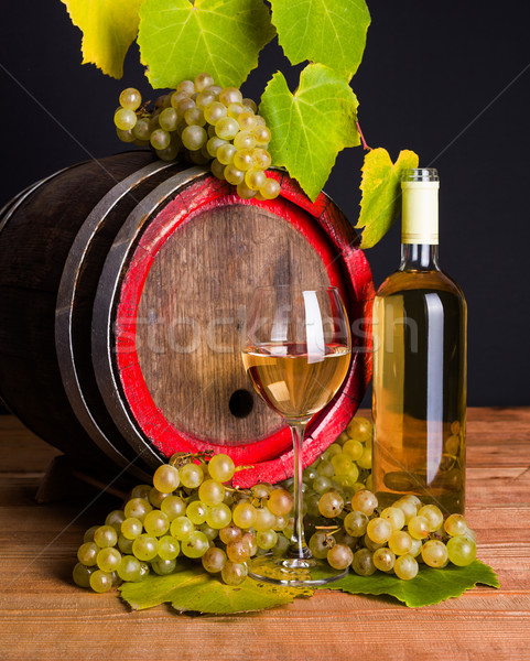 White wine and grapes in front of old barrel Stock photo © icefront