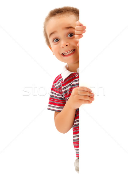 Funny boy mime scary expression behind wall Stock photo © icefront