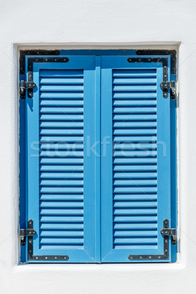Blue window with Bahama shutters Stock photo © icefront