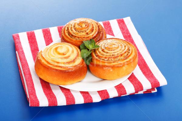 Three cinnamon rolls on white plate Stock photo © icefront