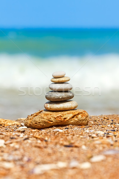 Stacked pebbles on the sea side Stock photo © icefront