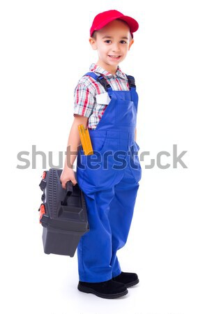 Little handyman carrying toolbox Stock photo © icefront