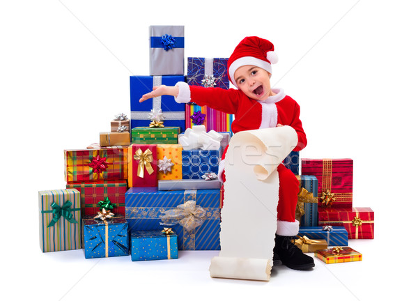 Little Christmas boy along gifts with wish list Stock photo © icefront