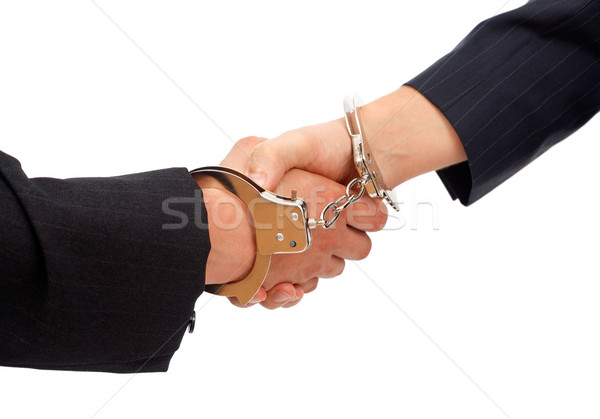 Handshake linked with handcuffs Stock photo © icefront