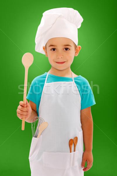 Kicsi szakács mutat fakanál kék boldog Stock fotó © icefront