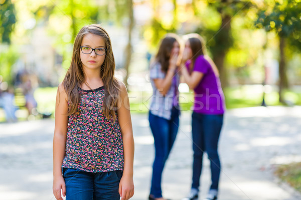 Envious girls discriminating her girlfriend Stock photo © icefront