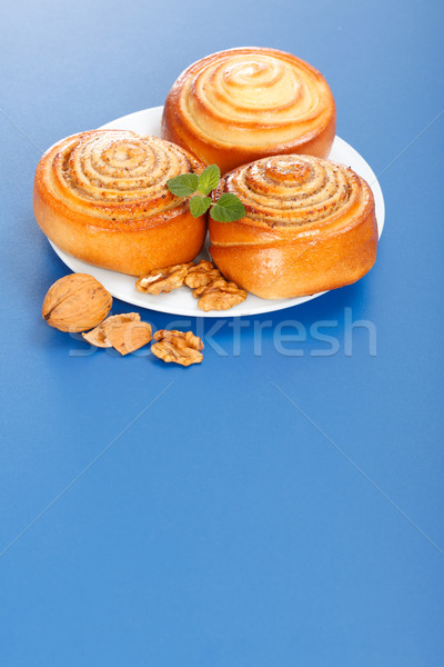 Three cinnamon rolls on plate Stock photo © icefront