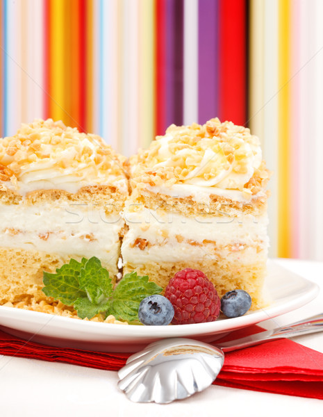 Closeup view of whipped cream cake garnished with berries Stock photo © icefront