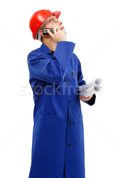 Engineer looking up while talking on the phone Stock photo © icefront