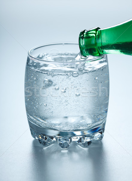 Mineral water pouring into glass Stock photo © icefront