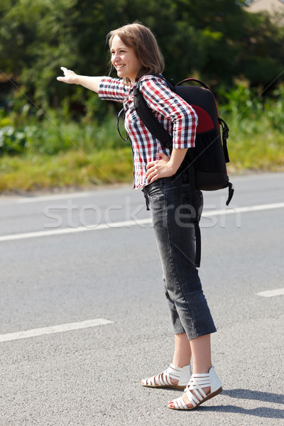 Teen girl hitch hiking Stock photo © icefront