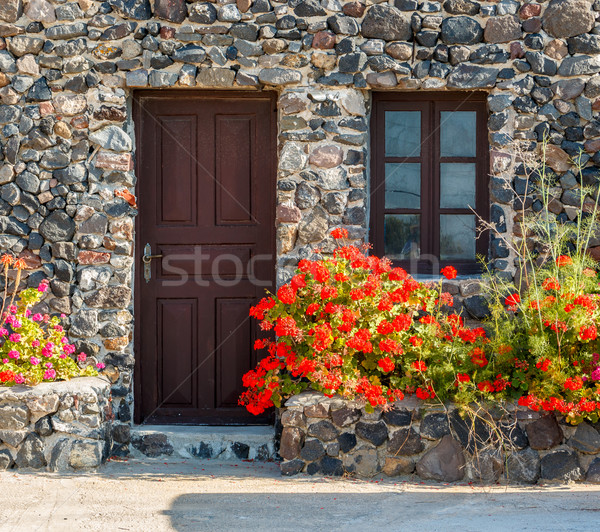 Greek stone house with geranium flowers Stock photo © icefront