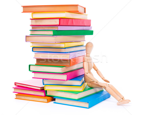 Wooden dummy puppet sitting on books Stock photo © icefront