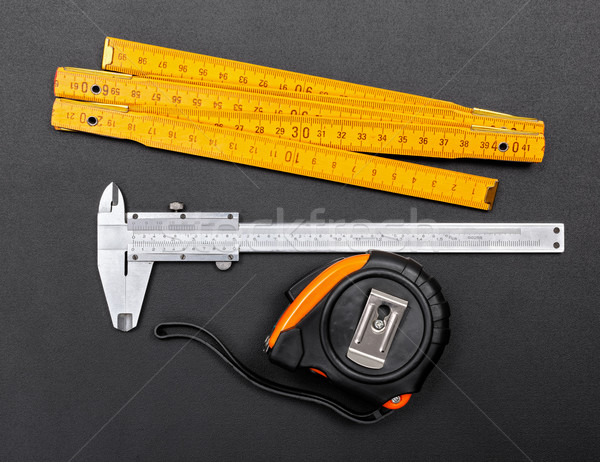 Measuring tools on black: ruler, caliper and tape Stock photo © icefront