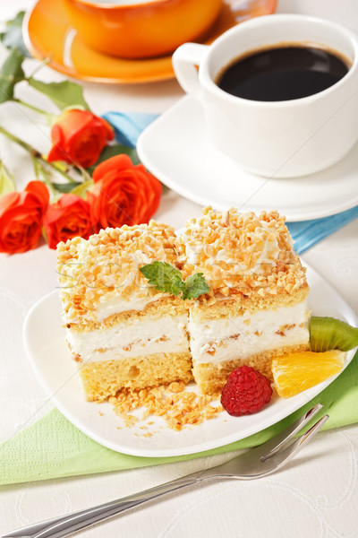 Top view of whipped cream cake garnished with fruit pieces Stock photo © icefront