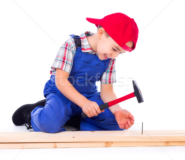 Little carpenter nailing Stock photo © icefront