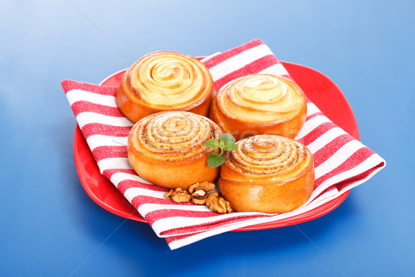 Four cinnamon rolls on red plate Stock photo © icefront