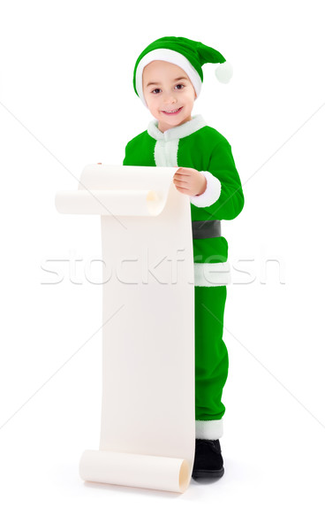 Little green Santa Claus boy showing wish list Stock photo © icefront