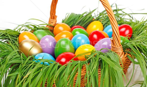 Színes húsvéti tojások kosár festett fonott tavasz Stock fotó © icefront