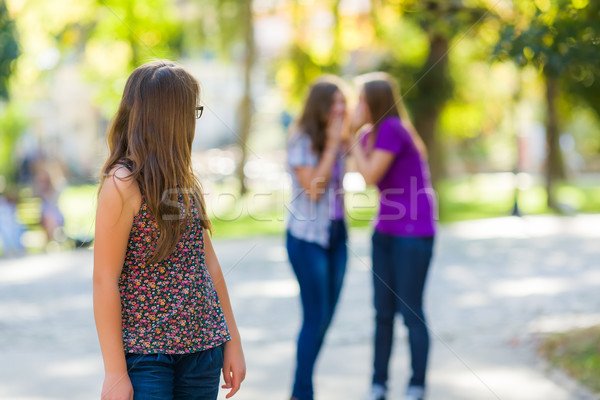 Girl looking back at her evil girlfriends Stock photo © icefront