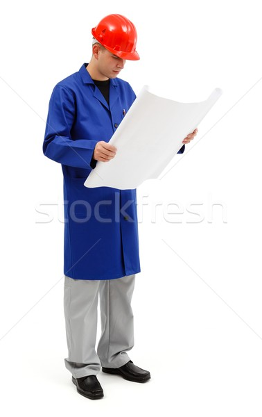 Young engineer looking at project plans Stock photo © icefront