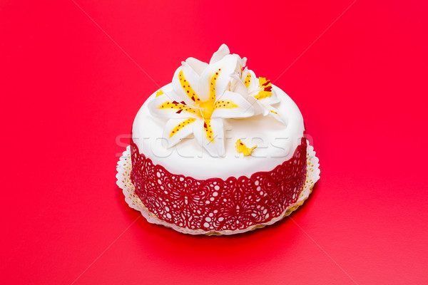 White fondant cake decorated with red lace and edible candy lily Stock photo © icefront