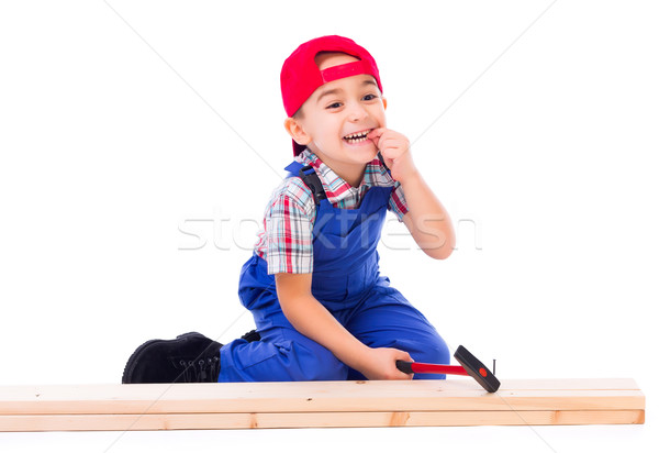 Little carpenter hit his finger while nailing Stock photo © icefront