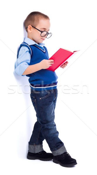 Little boy reading book near wall Stock photo © icefront
