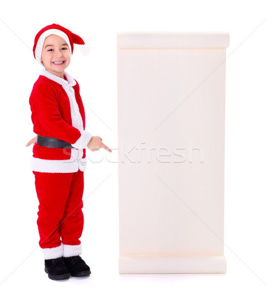 Little Santa Claus boy pointing at big wish list Stock photo © icefront