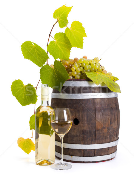 White wine with old barrel and grapes Stock photo © icefront