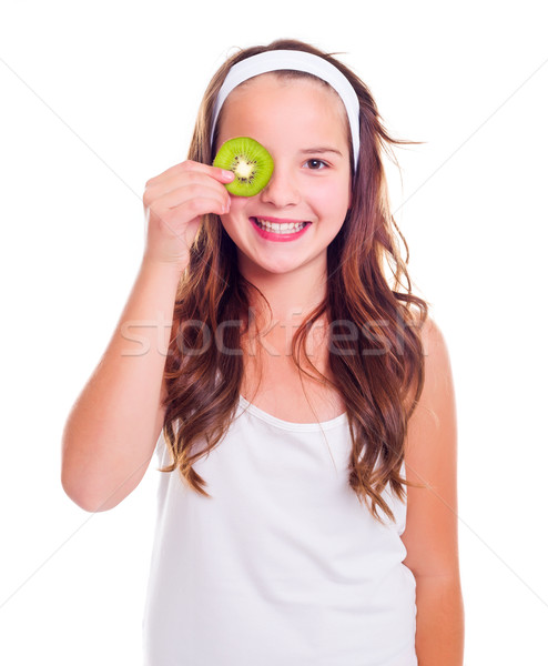Girl with kiwi slice over her eye Stock photo © icefront