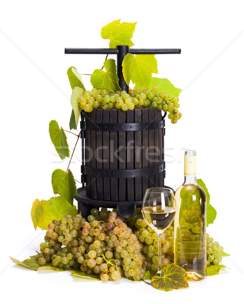 Manual grape pressing utensil with white wine Stock photo © icefront