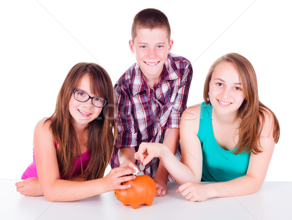 Adolescentes ahorro dinero futuro tres monedas Foto stock © icefront