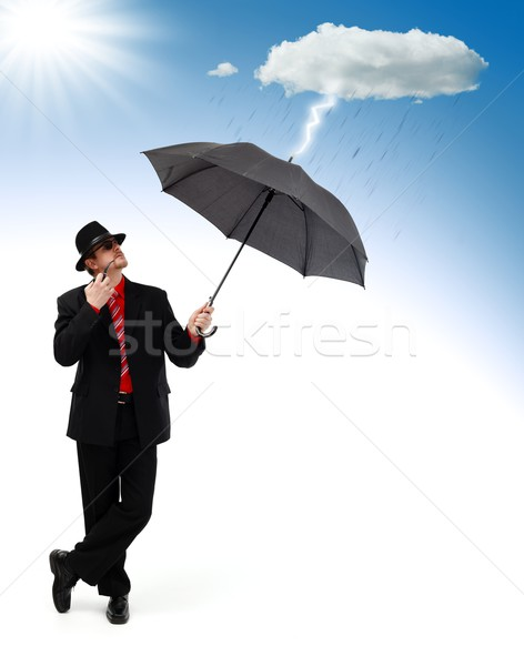 Man standing and protecting himself from disaster Stock photo © icefront