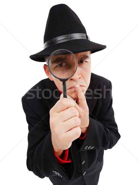 Sceptical detective looking through magnifying glass Stock photo © icefront