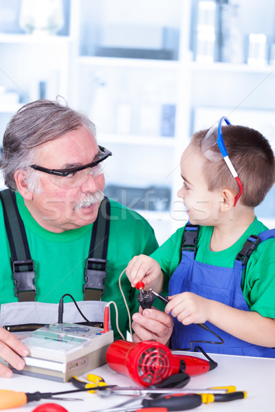 Grandfather and grandchild using multimeter Stock photo © icefront