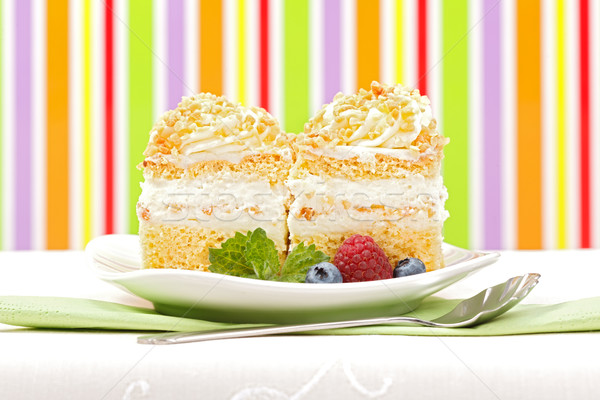Stock photo: Whipped cream cake garnished with berries