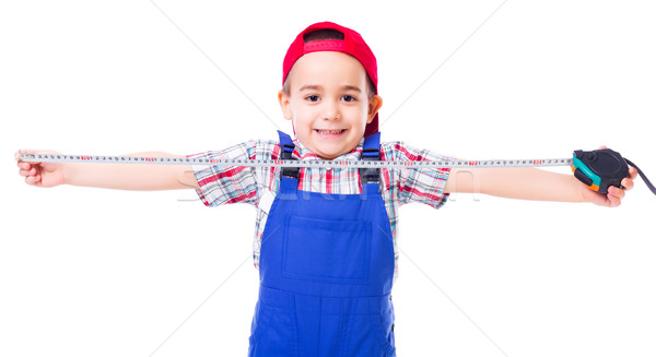 Little handyman with measuring tape Stock photo © icefront