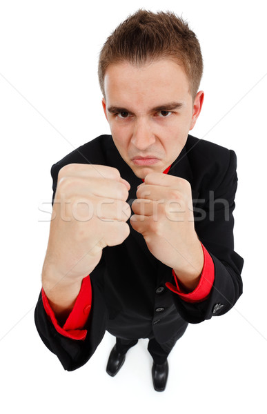 Angry businessman clenching his fists Stock photo © icefront