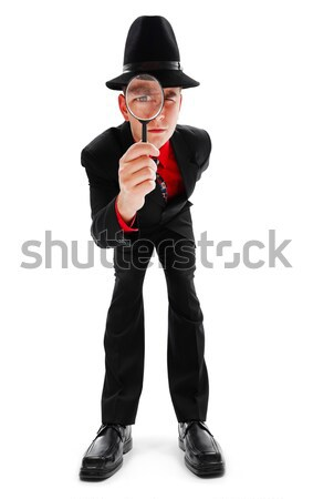 Young detective with magnifier Stock photo © icefront