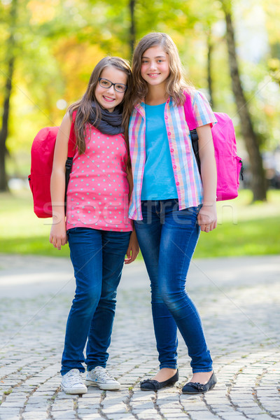 Teen friends with schoolbag Stock photo © icefront