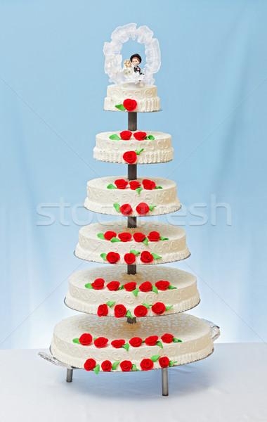 Fehér esküvői torta piros rózsa marcipán dekoráció virágok Stock fotó © icefront