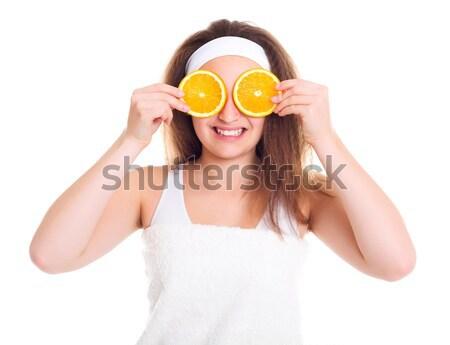Nina rodaja de naranja ojo adolescente cara belleza Foto stock © icefront