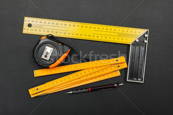 Measuring tools and pencil on black Stock photo © icefront