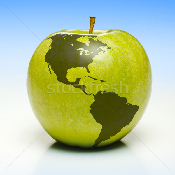 Green apple with earth map Stock photo © icefront