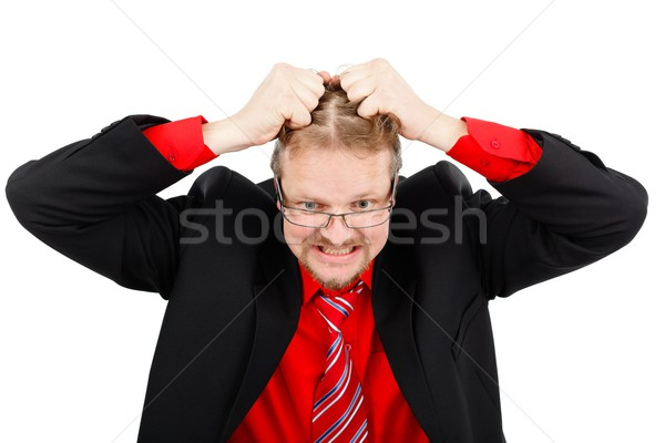 Distressed man pulling his hair Stock photo © icefront