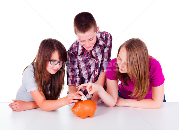Three teens collecting money together Stock photo © icefront