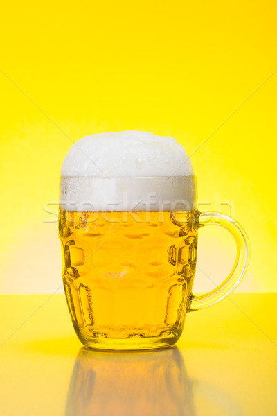 Mug with fresh, foamy beer Stock photo © icefront