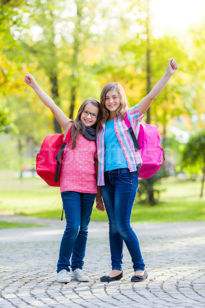 Happy teenage schoolgirls with schoolbag Stock photo © icefront