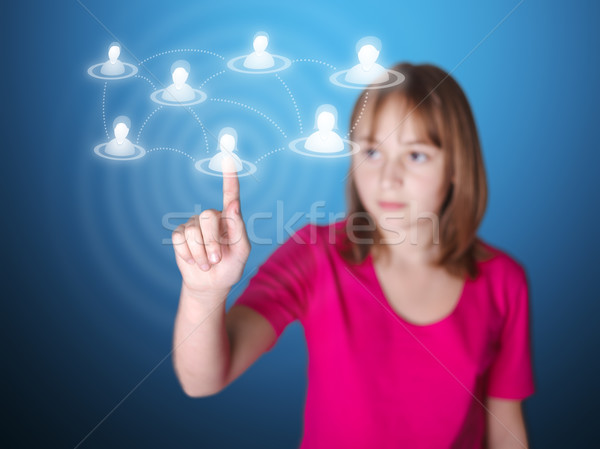 Girl pointing on touch screen a social network member Stock photo © icefront